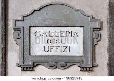 Galleria degli Uffizi, Uffizi Gallery, street plate on a wall of museum in Florence, region of Tuscany, Italy