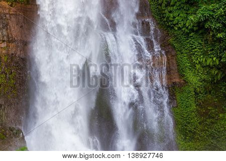 Gitgit Waterfall on Bali island Indonesia - travel and nature background