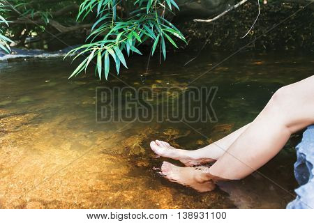 Women Leg And Feet Dip In Crystalline Stream