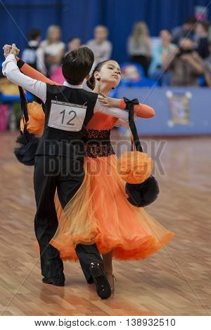 Minsk Belarus -May 28 2016: Gerasimchuk Vladislav and Zhuk Anastasiya Perform Juvenile-1 Standard European Program on National Championship of the Republic of Belarus in May 28 2016 in Minsk Republic of Belarus