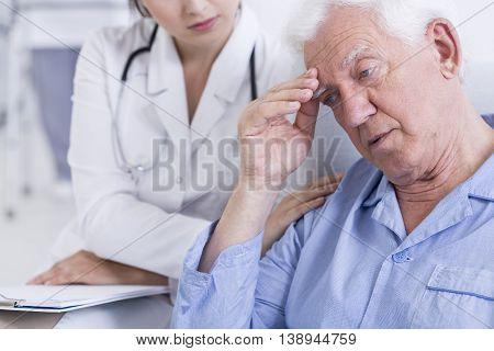 Shot of a worried elder man receiving bad news