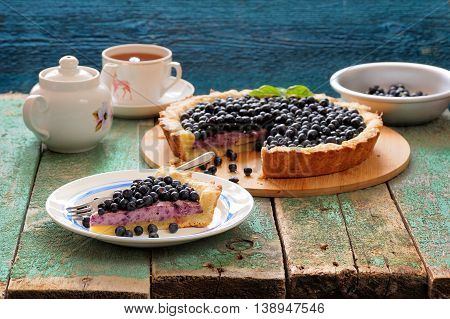 Yummy homemade open pie with cream cheese filling and fresh forest blueberries horizontal