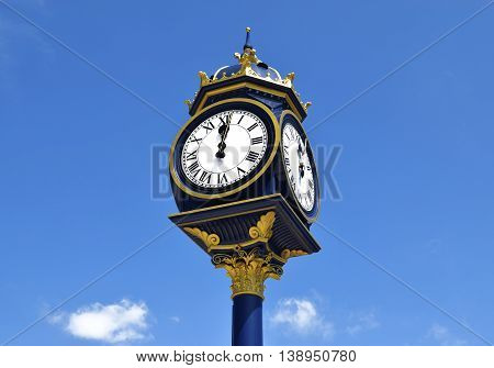 Big clock in Bearwood , Birmingham, on sunny day .  Big clock on the blue sky in United Kingdom