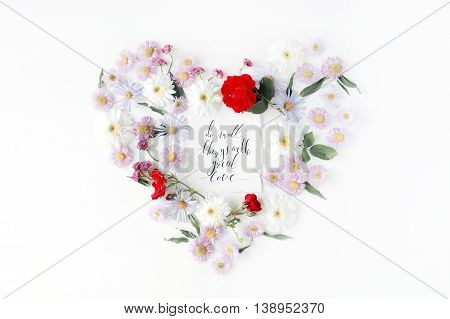 "inspirational quote ""Do small things with great love"" written in calligraphy style on paper with pink red roses chamomiles and leaves heart isolated on white background. Flat lay top view"