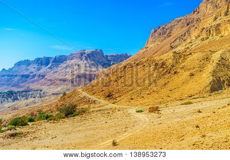 The narrow footpath connects two scenic canyons of Ein Gedi Nature Reserve in Judean desert Israel.