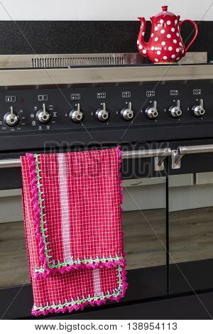 Homemade Crochet Dish Towel Hanging On A Stove