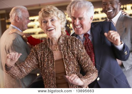 Couples Dancing Together At A Nightclub