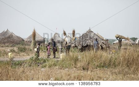 MANGALLA, SOUTH SUDAN-DECEMBER 1, 2010:Unidentified people draw water from a well along the Juba, Bor road in South Sudan