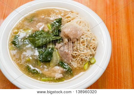 "Thin rice noodles and pork in thick gravy Thai Style food called ""Rad Na"""