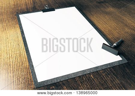 Closeup of blank clipboard and stamper on wooden surface. Mock up 3D Rendering