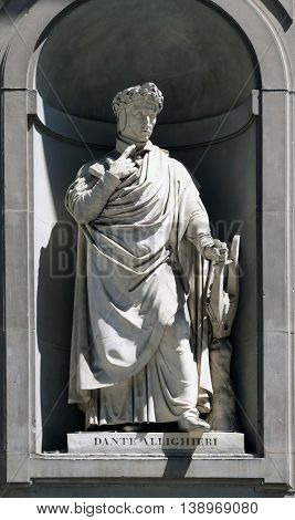 FLORENCE, ITALY - JUNE 05: Dante Alighieri in the Niches of the Uffizi Colonnade. The first half of the 19th Century they were occupied by 28 statues of famous people in Florence, on June 05, 2015