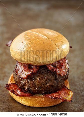 close up of rustic carnivore meat lover hamburger