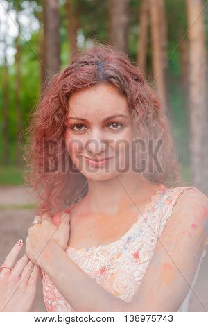Young Cheerful Woman with Holi Paint. Art Concept
