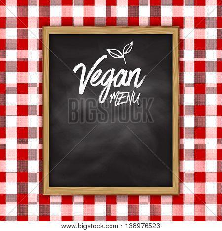 Vegan menu chalkboard design on a gingham cloth background