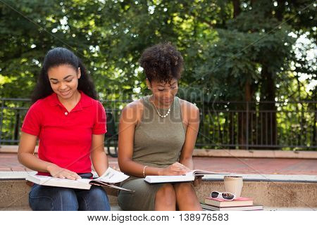 2 young african american college students studying on campus