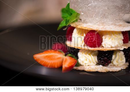 Dessert millefeuille with fresh berries and cream
