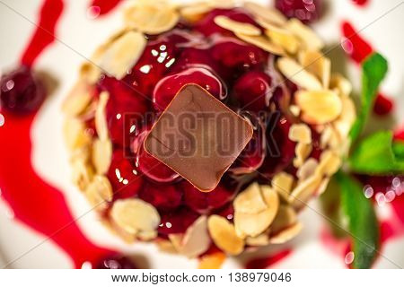 Dessert basket with berries and fruit jelly and chocolate