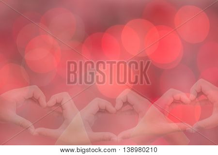 kid hands making a heart shape with sweet background