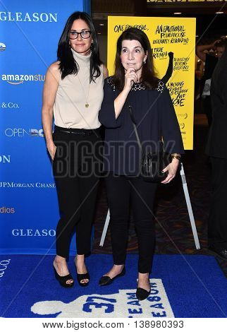 LOS ANGELES - JUL 14:  Courteney Cox & Nanci Ryder arrives to the