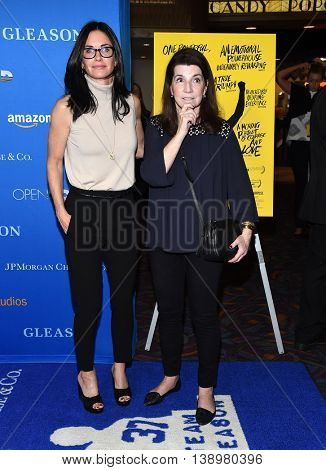 "LOS ANGELES - JUL 14:  Courteney Cox & Nanci Ryder arrives to the ""Gleason"" Los Angeles Premiere on July 14, 2016 in Los Angeles, CA"