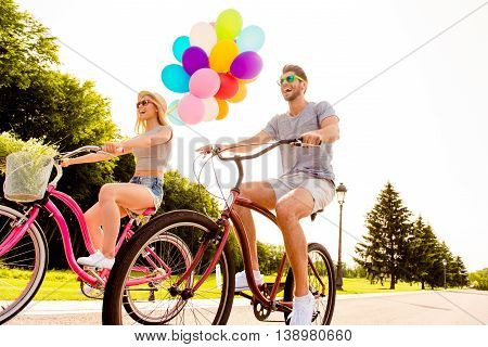 Positive Happy Couple In Love Having Fun And Riding Bicycles