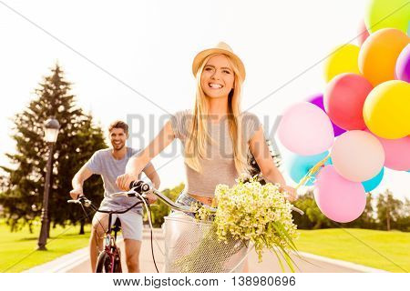 Pretty Smiling Girl Riding Bicycle With Her Boyfriend