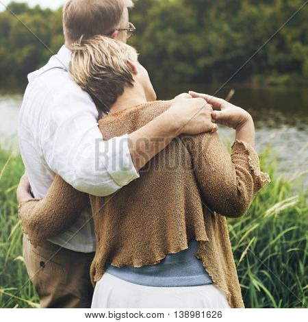 Cute Couple Embracing Outdoors Field Concept