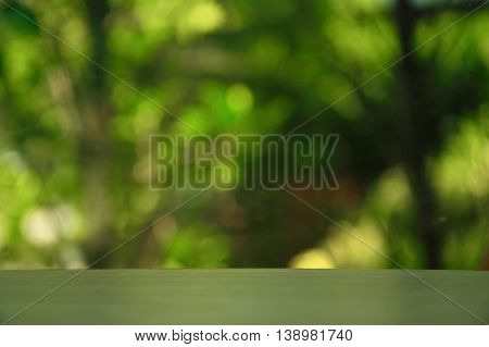 empty wood table with blur garden green background abstract