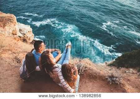 Family walking on the sea shore in sunset, travel photo series, top view