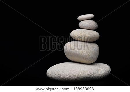 pile of white sand stones against black background