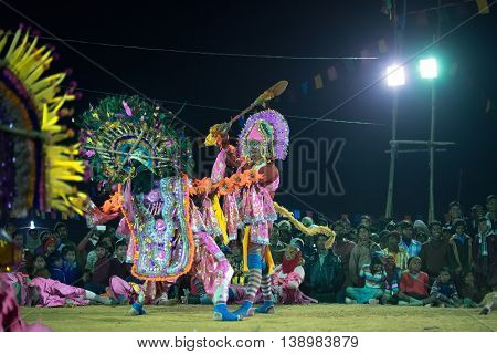 BAMNIA PURULIA WEST BENGAL INDIA - DECEMBER 23RD 2015 : Dancer dressed as Hanumanji is killing monster Chhau Dance festival. It is a very popular Indian tribal martial dance performed at night amongst spectators.