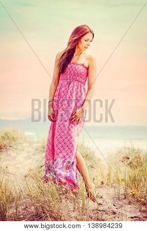Beautiful fashion model woman at the beach