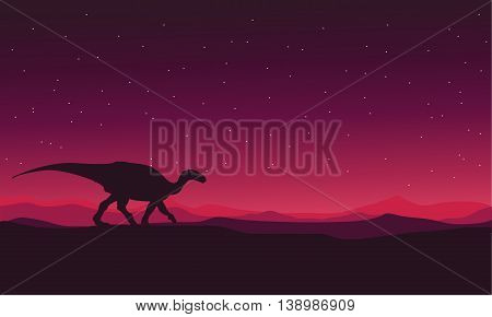 Landscape Iguanodon silhouettes vector on red backgrounds