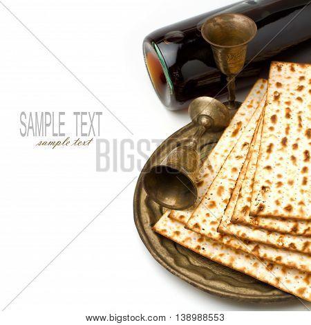 Matza and wine for passover seder celebration on white background