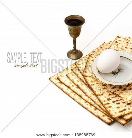 Matzo egg and wine for passover celebration on white background