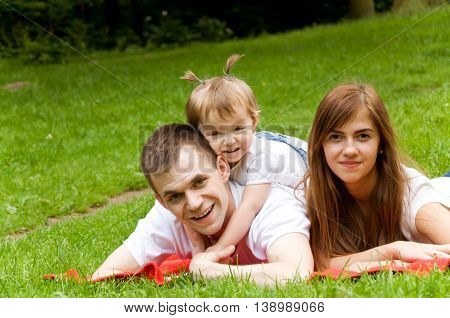 parents spend the weekend with their young daughter. Family camping