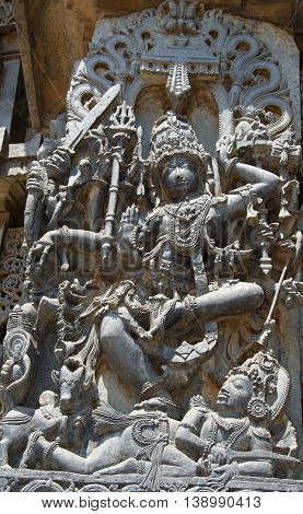 Lord Shiva killing a demon with Nandi overlooking in Hoysaleshwara temple at Halebidu Hassan district Karnataka state India Asia
