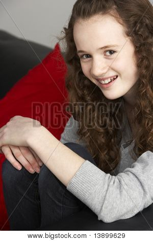 Teenage Girl Sitting On Sofa