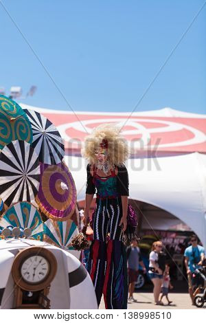 Costa Mesa, CA - July 16, 2016: Theatrical circus performer Megan Fontaine, part Mango and Dango, performs with Dragon Knights steampunk stilt walkers at the Orange County Fair in Costa Mesa, CA on July 16, 2016. Editorial use only.