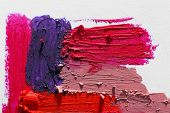 Smudged colourful lipstick on white background, close up poster
