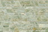 pattern color of modern style design decorative green slate stone wall surface with cement in trapezoid shape poster
