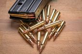 Ammunition in Magazine .223/556 on Wood Surface poster