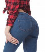 Fit female butt in blue jeans, isolated on white. Slim body. Pretty sexy woman model with amazing body. Hot buttocks. poster