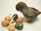 Colorful easter eggs and a duck to welcome Ester time poster