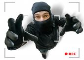 Masked thief or robber is recorded with security hidden camera. poster