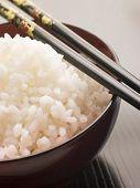 Bowl of Koshihikari Rice with chop sticks poster