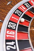 Close up of ball on roulette wheel with ball in number one slot poster