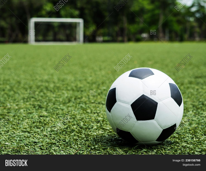 green grass football field. Football Field Soccer Ball On Green Grass , Background Texture