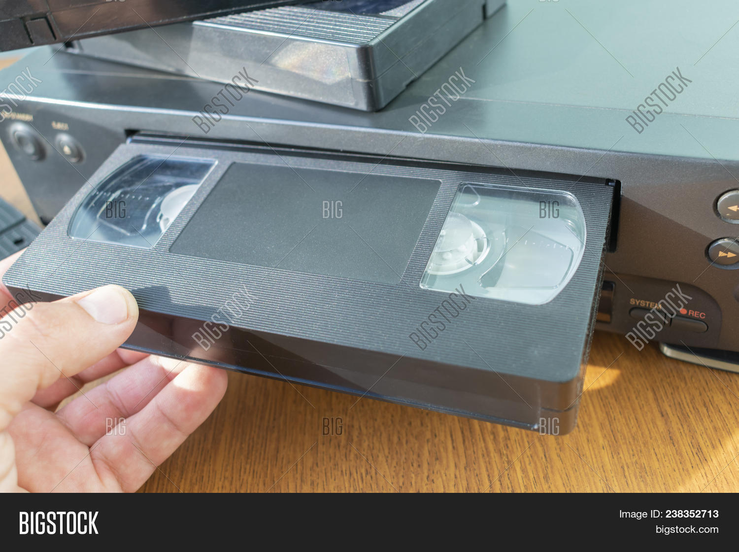 Videocassette Is Put Into The Video Recorder To Watch Another Cassette