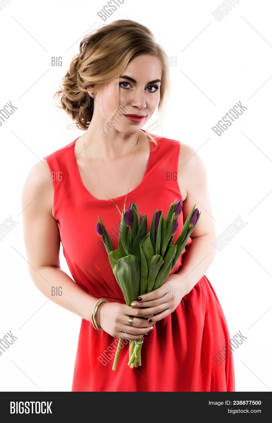Beautiful woman flowers tulips on image photo bigstock beautiful woman with flowers tulips on a light background izmirmasajfo